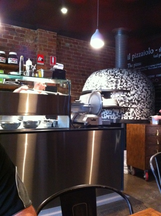 The mosaic covered woodfired oven with the two largest jars of nutella I have ever seen