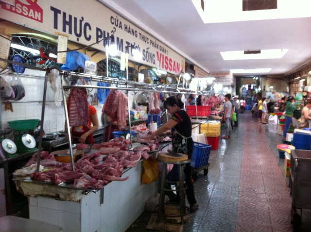 A butcher in  a local Vietnamese market